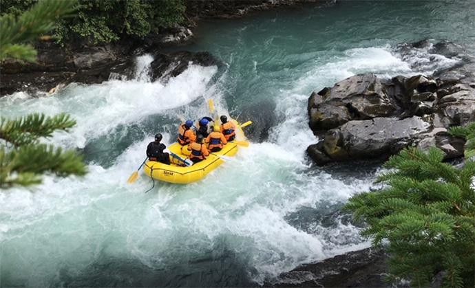 A group white water rafting in Alaska.