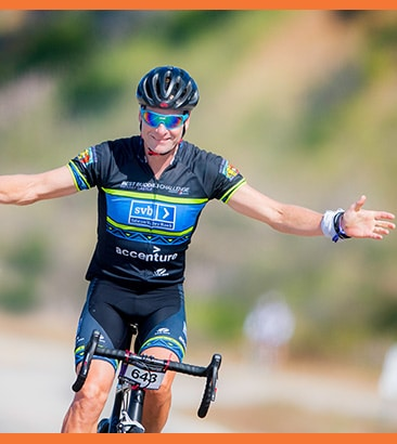 cyclist with arms spread in celebration